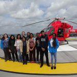 Summer school students on the helipad