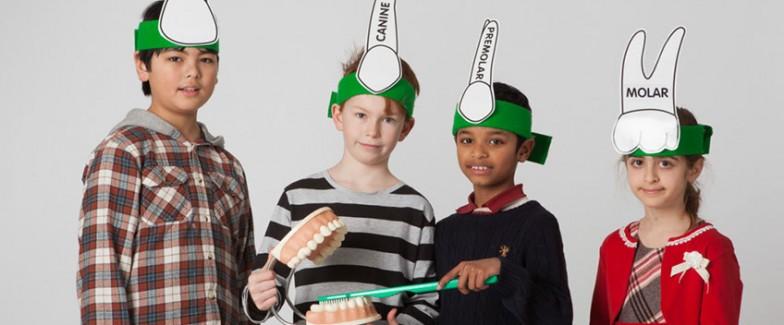 Children dressed up as teeth
