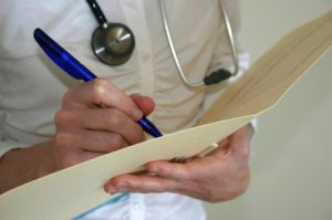 Picture of a GP taking medical notes